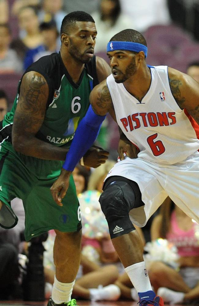 Maccabi Haifa forward Donta Smith (6) blocks the path of Detroit Pistons forward Josh Smith (6) during the first quarter of an NBA preseason basketball game at the Palace of Auburn Hills, Mich., Tuesday, Oct. 8, 2013