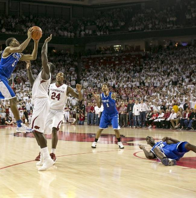 Kentucky guard Andrew Harrison, (5), attempts a last second shot as Arkansas forward Alandise Harris, (2), attempts to block during the second half of an NCAA college basketball game on Tuesday, Jan. 14, 2014, in Fayetteville, Ark