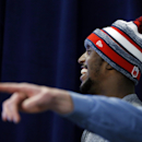 New England Patriots football free safety Devin McCourty laughs as he listens to teammate Vince Wilfork during a news conference in Foxborough, Mass., Friday, Jan. 23, 2015. The Patriots face the Seattle Seahawks in NFL football's Super Bowl XLIX on Sunda