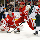 Detroit Red Wings goalie Petr Mrazek (34) stops a Minnesota Wild center Ryan Carter (18) shot as defenseman Jonathan Ericsson (52) defends in the third period of an NHL hockey game in Detroit Tuesday, Jan. 20, 2015 The Associated Press