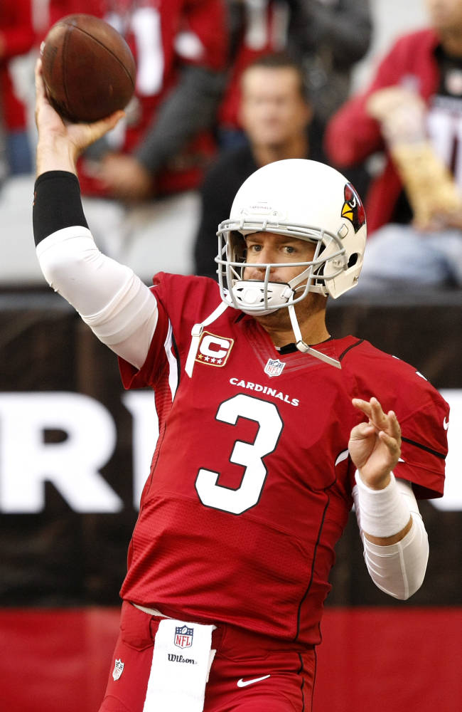 Arizona Cardinals quarterback Carson Palmer (3) warms up prior to an NFL football game against the St. Louis Rams, Sunday, Dec. 8, 2013, in Glendale, Ariz