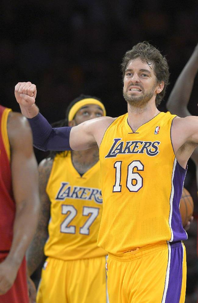 Los Angeles Lakers center Pau Gasol, of Spain, reacts after the Lakers turned over the ball, as Cleveland Cavaliers forward Tristan Thompson walks nearby during the first half of an NBA basketball game, Tuesday, Jan. 14, 2014, in Los Angeles