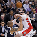 Toronto Raptors guard Nando De Colo, right, collides with teammate Kyle Lowry, bottom and Oklahoma Thunder forward Caron Butler (2) during the second half of an NBA basketball game in Toronto on Friday, March 21, 2014 The Associated Press