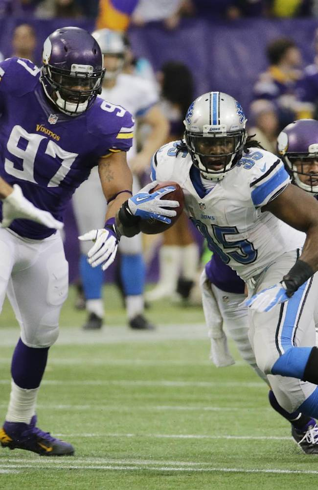 Detroit Lions running back Joique Bell (35) runs from Minnesota Vikings defensive end Everson Griffen (97) during the second half of an NFL football game on Sunday, Dec. 29, 2013, in Minneapolis