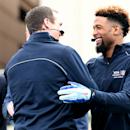 IMAGE DISTRIBUTED FOR VISA - New Orleans Saints' Drew Brees, left, celebrates with New York Giants' Odell Beckham Jr. after setting the Guinness World Record for the most one handed catches in one minute with 33, Thursday, Jan. 29, 2015 in Scottsdale, Ari
