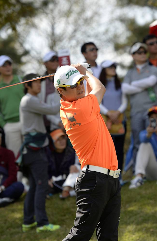 In this photo released by OneAsia, Kim Hyung-tae of South Korea watches his shot during the final round of the Korea Open golf tournament at Woo Jeong Hills Country Club near Cheonan, South Korea, Sunday, Oct. 20, 2013