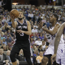 San Antonio Spurs guard Marco Belinelli, left, of Italy, drives to the basket against Sacramento Kings forward Jason Thompson during the fourth quarter of an NBA basketball game in Sacramento, Calif., Friday, March 21, 2014. The Spurs won 99-79 The As