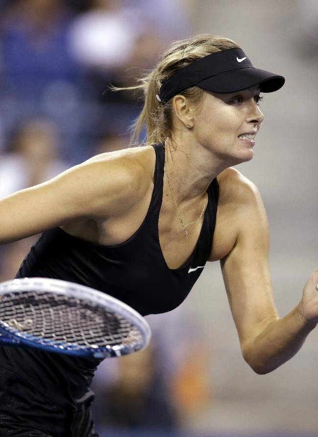Maria Sharapova, of Russia, runs after a shot by Sabine Lisicki, of Germany, during the third round of the U.S. Open tennis tournament Friday, Aug. 29, 2014, in New York