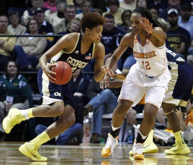 Georgia Tech guard Aaliyah Whiteside (2) drives against Tennessee forward Bashaara Graves (12) in the second half of an NCAA college basketball game on Sunday, Nov. 17, 2013, in Knoxville, Tenn. Tennessee won 87-76