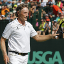 Bernhard Langer waves to the crowd on the 18th green during the final round of the 2014 U.S. Senior Open golf tournament at Oak Tree National in Edmond, Okla., Sunday, July 13, 2014. (AP Photo/Sue Ogrocki)
