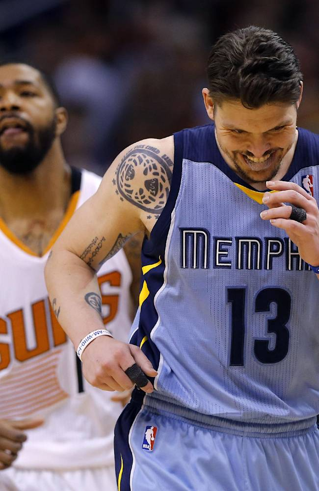 Memphis Grizzlies' Mike Miller (13) smiles after hitting a three-pointer as Phoenix Suns' Markeiff Morris looks away during the second half of an NBA basketball game, Monday, April 14, 2014, in Phoenix. The Grizzlies won 97-91