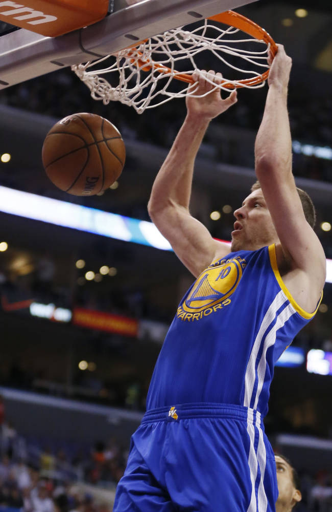 Golden State Warriors David Lee dunks against the Los Angeles Clippers during the first half of an NBA basketball game in Los Angeles, Wednesday, March 12, 2014