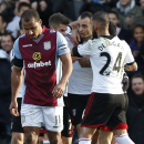 Fulham's Dimitar Berbatov, center, celebrates his penalty goal against Aston Villa with teammates during their English Premier League soccer match at Craven Cottage, London, Sunday, Dec. 8, 2013