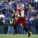 In this Nov. 29, 2013 file photo, Arkansas quarterback Brandon Allen (10) rolls out in the second half of an NCAA college football game against LSU in Baton Rouge, La. Bret Bielema has left little doubt this spring that Brandon Allen is Arkansas' best opt