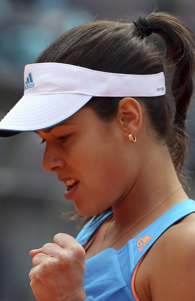 Serbia's Ana Ivanovic celebrates after winning a point against Russia's Maria Sharapova at the Italian open tennis tournament in Rome, Thursday, May 15, 2014