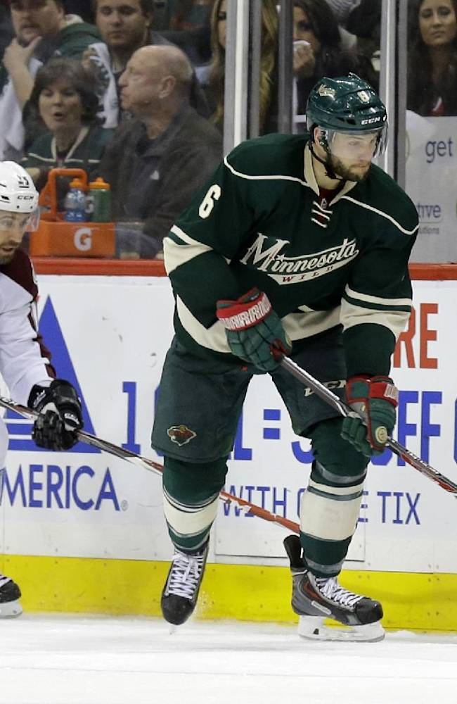 Minnesota Wild defenseman Marco Scandella (6) controls the puck in front of Colorado Avalanche center Maxime Talbot (25) during the second period of Game 3 of an NHL hockey first-round playoff series in St. Paul, Minn., Monday, April 21, 2014