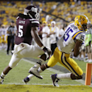 LSU wide receiver Malachi Dupre (15) pulls in a touchdown reception in front of Mississippi State defensive back Jamerson Love (5) to pull within five points in the second half of an NCAA college football game in Baton Rouge, La., Saturday, Sept. 20, 2014. Mississippi State won 34-29. (AP Photo/Gerald Herbert)