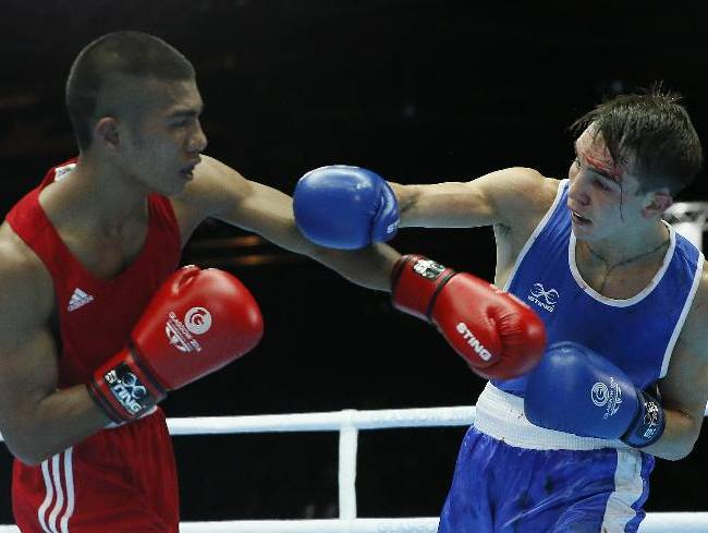 Michael Conlan of Northern Ireland, left, fights Matthew Martin from Nauru during their men's bantam weight (56kg) boxing bout at the Commonwealth Games Glasgow 2014, in Glasgow, Scotland, Friday, July, 25, 2014