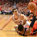 Washington Wizards guard Bradley Beal (3) wins a scramble for the ball with Chicago Bulls guard Kirk Hinrich (12) during Game 2 in an opening-round NBA basketball playoff series Tuesday, April 22, 2014, in Chicago. The Wizards won 101-99 The Associated P