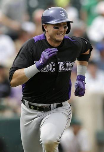 Colorado Rockies' Troy Tulowitzki runs down the first base line on a double against the Oakland Athletics during the third inning of an exhibition spring training baseball game on Wednesday, March 27, 2013 in Phoenix