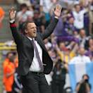 Belgium's RSC Anderlecht coach John Van Den Brom, center, after winning the final soccer match of the Belgian League against SV Zulte Waregem at the Constant Vanden Stock stadium in Brussels, Sunday, May 19, 2013. (AP Photo/Yves Logghe)