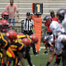 In a photo provided by the NFL, line judge Catherine Conti signals from the sideline at the Legacy Bowl Women's Football Championship, on Friday July 25, 2014, in Rock Hill, S.C. The 38-year-old Conti had been assigned to the Southeast Missouri State-Kans