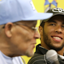 In this photo taken Oct. 27, 2013, Darrell Wallace Jr., right, winner of Saturday's NASCAR Camping World Truck race, smiles as he listens to Wendell Scott Jr., left, during a news conference at Martinsville Speedway in Martinsville, Va. Wallace Jr. was the first black driver to win a NASCAR race since the 1960s when he took the checkered flag in a Truck Series race at Martinsville. (AP Photo/Steve Helber)
