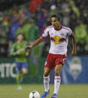 New York Red Bulls' Tim Cahill (17) dribbles the ball against the Seattle Sounders in the second half of an MLS soccer match, Sunday, Sept. 29, 2013, in Seattle. (AP Photo/Ted S. Warren)