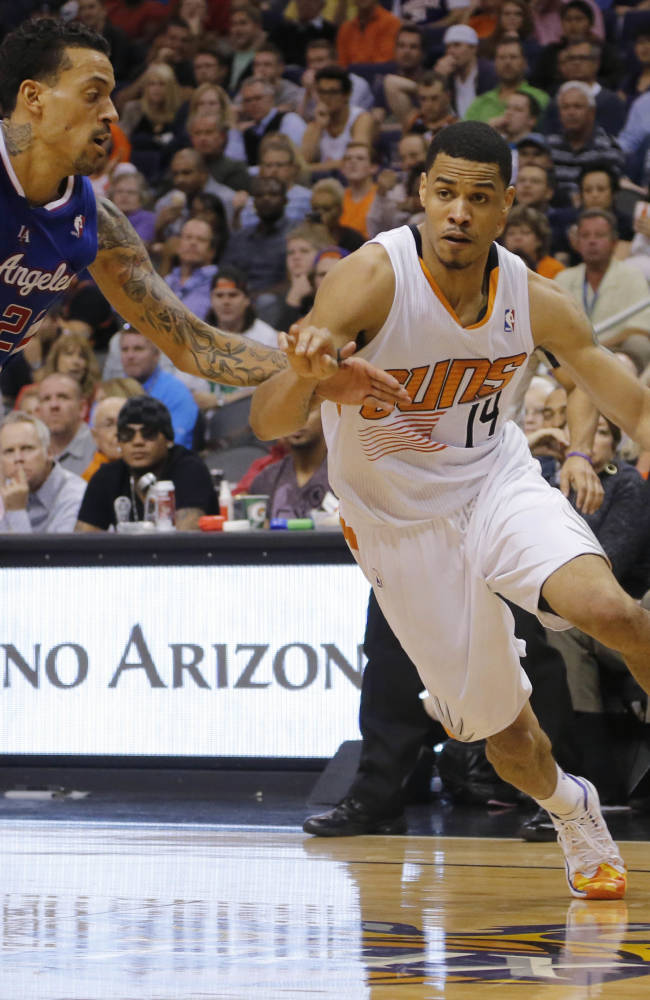 Phoenix Suns' Gerald Green (14), drives past Los Angeles Clippers' Matt Barnes during the second half of an NBA basketball game, Tuesday, March 4, 2014, in Phoenix. The Clippers won 104-96