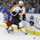 Philadelphia Flyers' Scott Hartnell (19) looks to pass after checking New York Rangers' Ryan McDonagh (27) during the first period of Game 1 of an NHL hockey first-round playoff series on Thursday, April 17, 2014, in New York The Associated Press