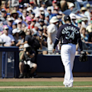 Seattle Mariners starting pitcher Felix Hernandez walks to the dugout after being taken out during the third inning of an exhibition spring training baseball game against the Texas Rangers, Sunday, March 9, 2014, in Peoria, Ariz The Associated Press