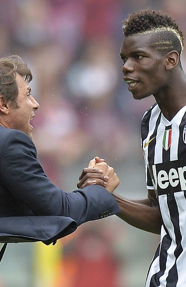 Juventus coach Antonio Conte, left, celebrates with French midfielder Paul Pogba after a Serie A soccer match between Torino and Juventus, at the Olympic stadium, in Turin, Italy, Sunday, Sept. 29, 2013. Juventus earned a narrow 1-0 win in a heated derby match at city rival Torino on Sunday, to move provisionally top of the table with Napoli. Paul Pogba scored a contentious 54th minute winner, heading in the rebound after Carlos Tevez's header came off the crossbar. There were fierce protests from Torino, however, as Tevez appeared to be offside