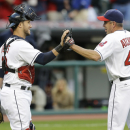 Cleveland Indians relief pitcher Scott Atchison, right, is congratulated by catcher Yan Gomes after the Indians defeated the Kansas City Royals 4-3 in 10 innings in a suspended Aug. 31, 2014 baseball game, Monday, Sept. 22, 2014, in Cleveland. (AP Photo/Tony Dejak)