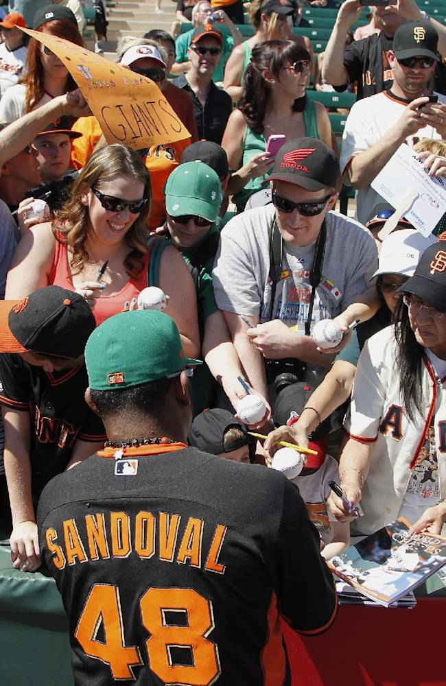 San Francisco Giants' Pablo Sandoval signs autographs prior to a spring training baseball game against the Los Angeles Angels, Monday, March 17, 2014, in Tempe, Ariz.  The Angels defeated the Giants 8-7