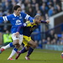 Everton's Steven Pienaar, left, fights for the ball against Swansea City's Ashley Richards during their English FA Cup fifth round soccer match at Goodison Park Stadium, Liverpool, England, Sunday Feb. 16, 2014