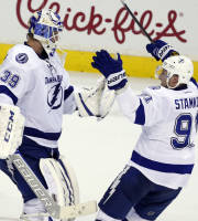 Tampa Bay Lightning goalie Anders Lindback, left, from Sweden, celebrates with center Steven Stamkos after an NHL hockey game against the Washington Capitals, Sunday, April 13, 2014, in Washington. The Lightning won 1-0 in a shootout. (AP Photo/Alex Brandon)