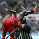 In this file photo dated Saturday, Nov. 1, 2014, Newcastle United's Steven Taylor, right, vies for the ball with Liverpool's Mario Balotelli, left, during their English Premier League soccer match at St James' Park, Newcastle, England