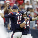Houston Texans' Ryan Fitzpatrick (14) and Ryan Mallett (15) celebrates a score against the Buffalo Bills during the second quarter of an NFL football game, Sunday, Sept. 28, 2014, in Houston. The Associated Press