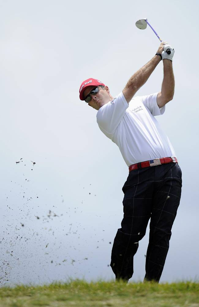 Kevin Streelman of the U.S. hits an approach shot on the second hole during the final round of the World Cup of Golf at Royal Melbourne Golf Course in Australia, Sunday, Nov. 24, 2013
