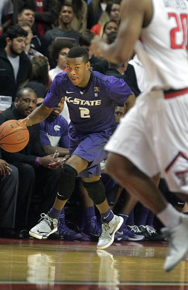 Kansas State's Marcus Foster (2) looks to drive around Texas Tech's Toddrick Gotcher (20) during an NCAA college basketball game in Lubbock, Texas, Tuesday, Feb, 25, 2014