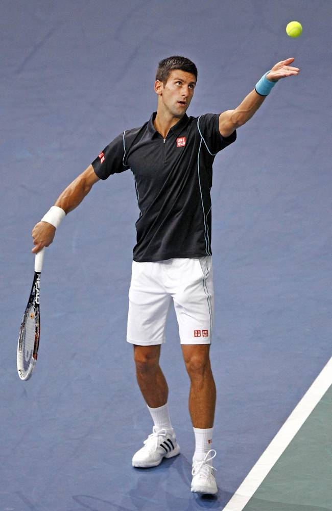 Serbia's Novak Djokovic serves to Switzerland's Roger Federer during their semifinal match, at the Paris Masters tennis, in the Paris Bercy stadium, Saturday Nov. 2, 2013