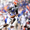Florida defensive back Keanu Neal (42) walks away after making an interception against Tennessee during the second half of an NCAA college football game at Neyland Stadium, Saturday, Oct. 4, 2014, in Knoxville, Tenn The Associated Press