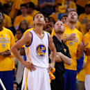 OAKLAND, CA - MAY 21: Stephen Curry #30 of the Golden State Warriors and teammates watch a replay in the second half against the Houston Rockets during game two of the Western Conference Finals of the 2015 NBA PLayoffs at ORACLE Arena on May 21, 2015 in Oakland, California. (Photo by Ezra Shaw/Getty Images)