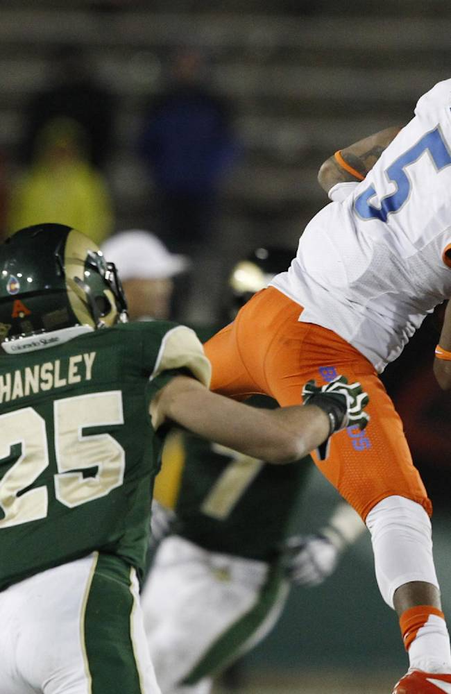 Boise State cornerback Donte Deayon, right, intercepts a pass intended for Colorado State wide receiver Joe Hansley in the fourth quarter of Boise State's 42-30 victory in an NCAA college football game in Fort Collins, Colo., Saturday, Nov. 2, 2013. The interception stalled a Colorado State drive
