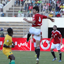 Egyptian player Ashour Hossain, right, goes for the ball while Zimbabwean player Knowledge Musona looks on  during the World Cup Qualifier match  against Zimbabwe at the National Sports Stadium in Harare, Sunday, June, 9, 2013. Egypt won the the crucial World Cup qualifier match against the Southern African nation, 4-2. (AP Photo/Tsvangirayi Mukwazhi)