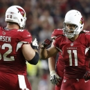 Arizona Cardinals' Larry Fitzgerald (11) pumps his fist in celebration with teammate Ted Larsen (62) after a late first down by the Cardinals against the Kansas City Chiefs during the second half of an NFL football game Sunday, Dec. 7, 2014, in Glendale,