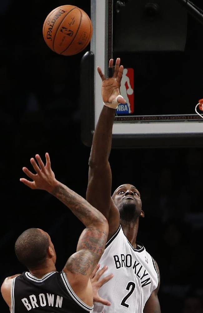 Brooklyn Nets' Kevin Garnett (2) defends against a shot from San Antonio Spurs' Shannon Brown during the second half of an NBA basketball game on Thursday, Feb. 6, 2014, in New York. Brooklyn won 103-89