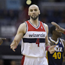 Washington Wizards center Marcin Gortat (4) is congratulated by teammates after scoring during the second half of an NBA basketball game against the Utah Jazz on Wednesday, March 5, 2014, in Washington. The Wizards defeated the Jazz 104-91 The Associated