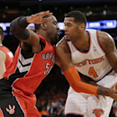 Toronto Raptors' Patrick Patterson (54) defends New York Knicks' Jeremy Tyler (4) during the first half of an NBA basketball game Wednesday, April 16, 2014, in New York The Associated Press