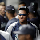 Seattle Mariners' Felix Hernandez walks through the dugout in the fourth inning of an exhibition baseball against the San Diego Padres, Friday Feb. 28, 2014, in Peoria, Ariz The Associated Press